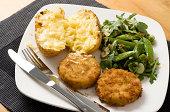 Fishcakes with baked potato and salad