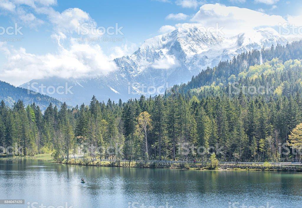 Fisher at Lake Hintersee, Berchtesgadener Land, Bavaria, Germany stock photo