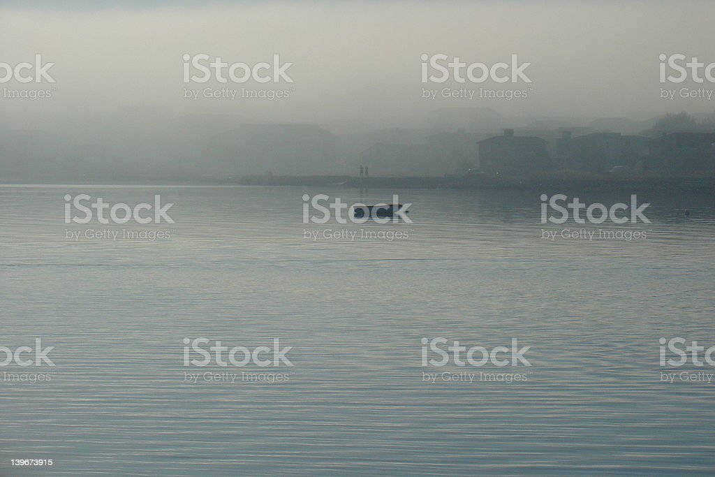Fisher Boat in morning fog stock photo