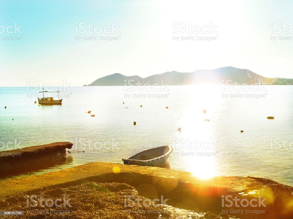 fisher boats at sunset stock photo