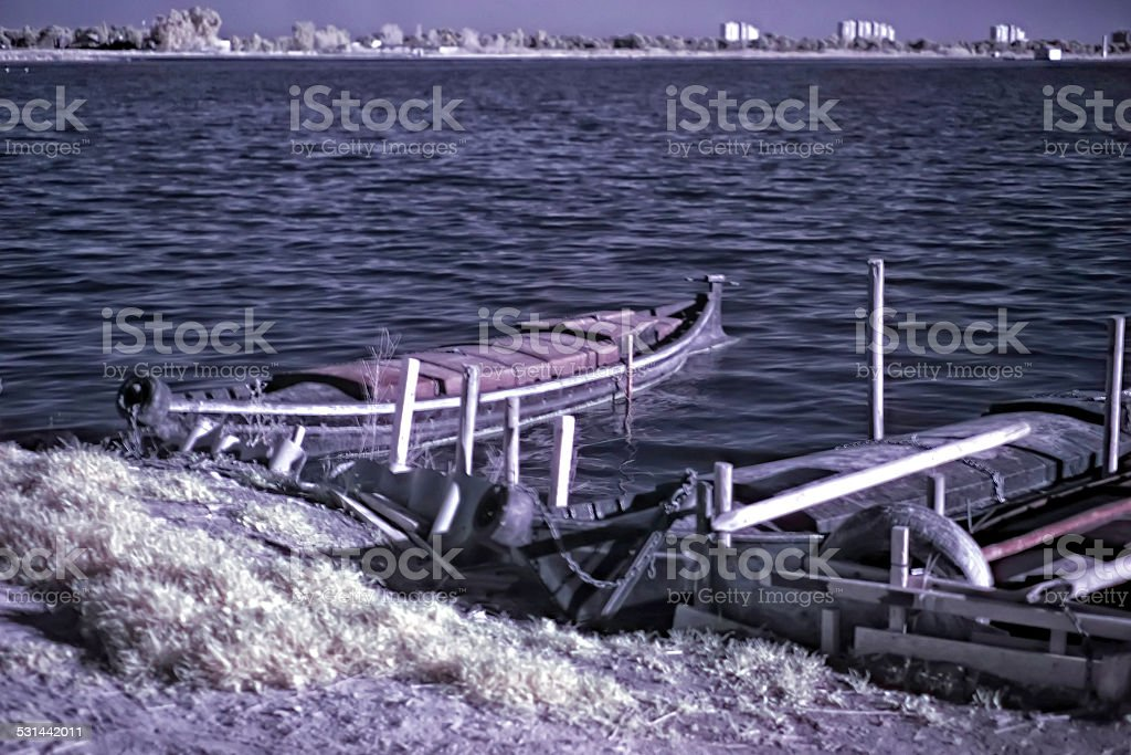 Fisher boats docked at lake. Infrared photogrphy. stock photo