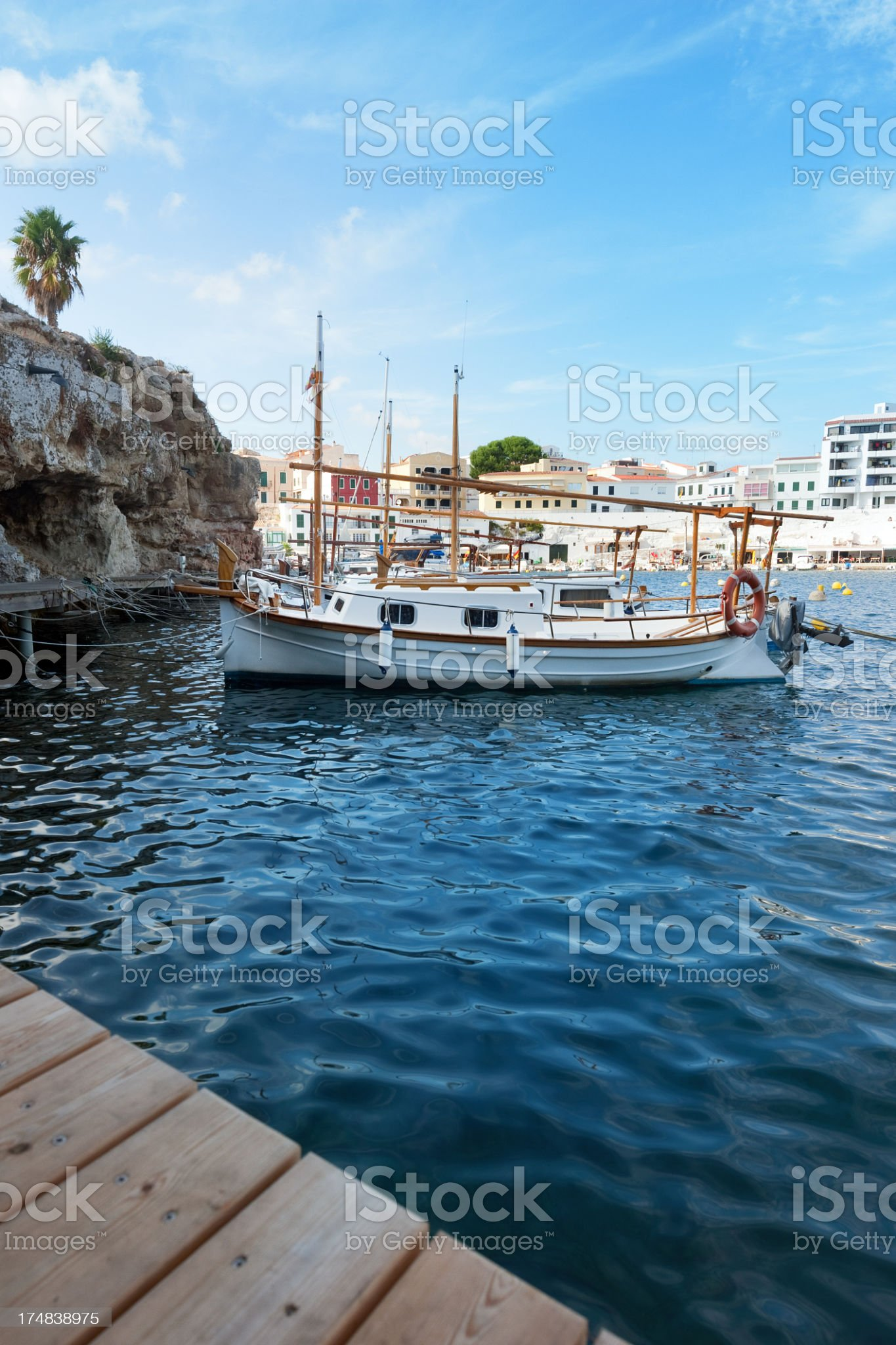 Fisher boats floating in a bay royalty-free stock photo