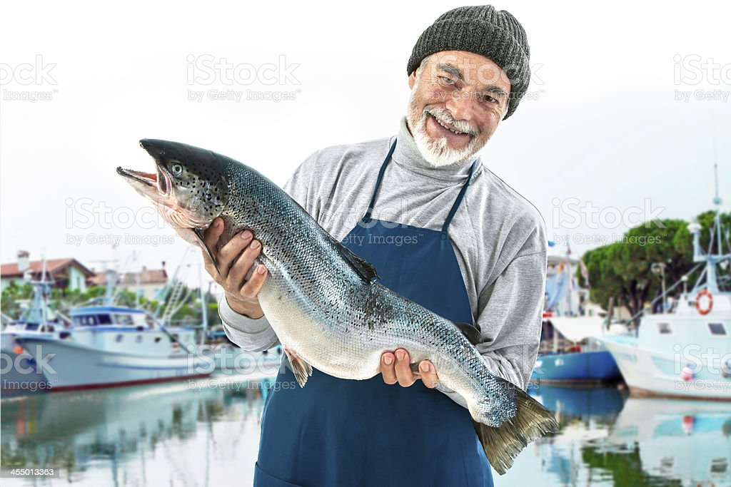 Fisher holding a big atlantic salmon fish stock photo