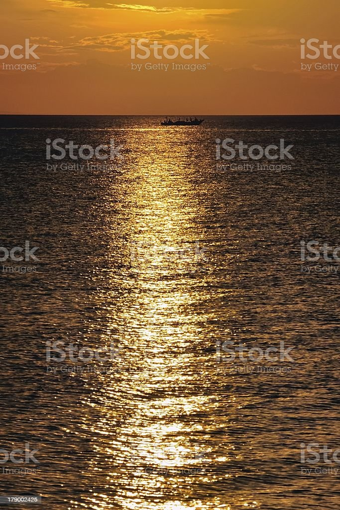fisher in the sunset royalty-free stock photo
