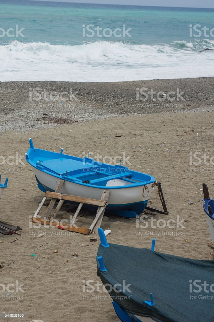 Fisherboat on the beach stock photo
