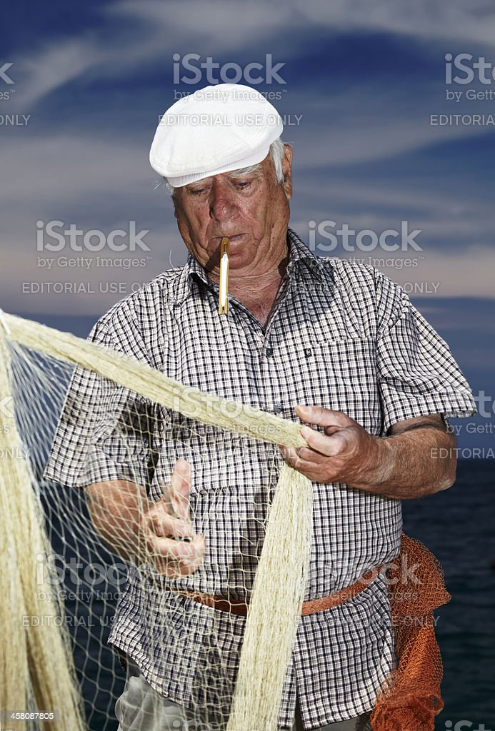 Fishereman kniting a net stock photo