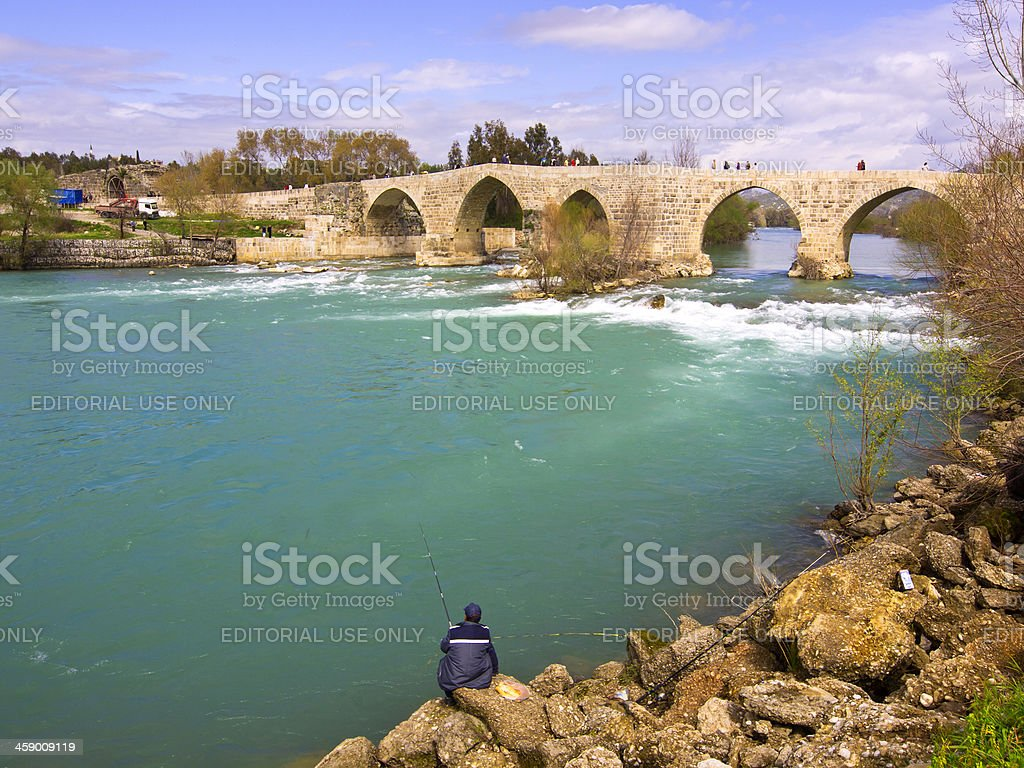 Fisherman and bidge stock photo