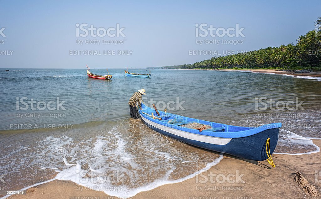 Fisherman and boats, Cherai beach, Thottada, Kannur, Kerala, Ind stock photo