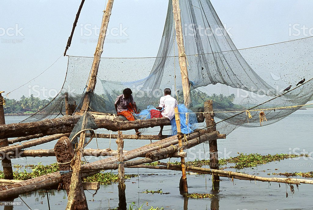 Fisherman and Chinese Fishing Nets stock photo