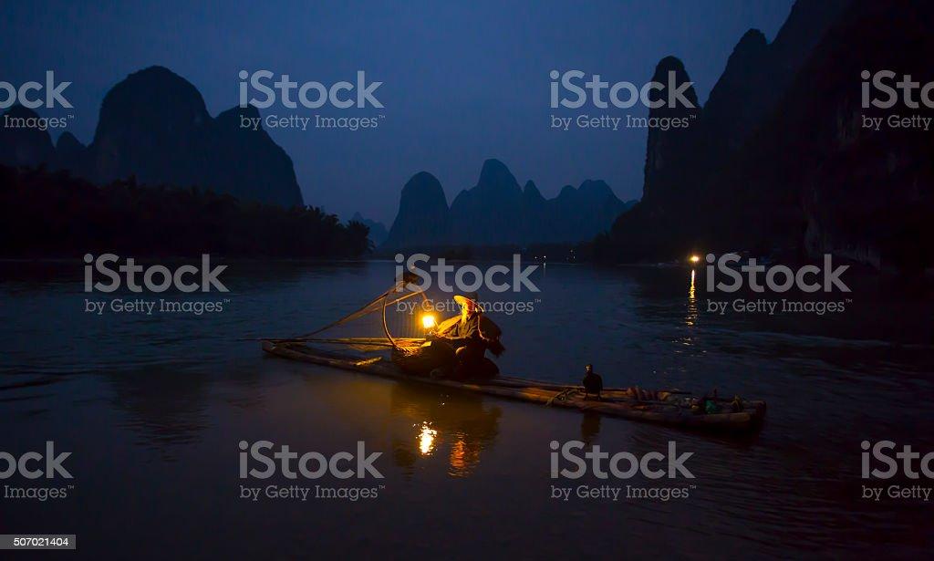 Fisherman and osprey stock photo