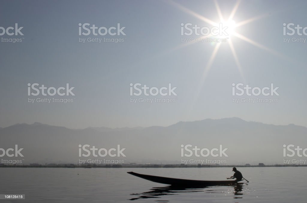 Fisherman and Sun Star stock photo