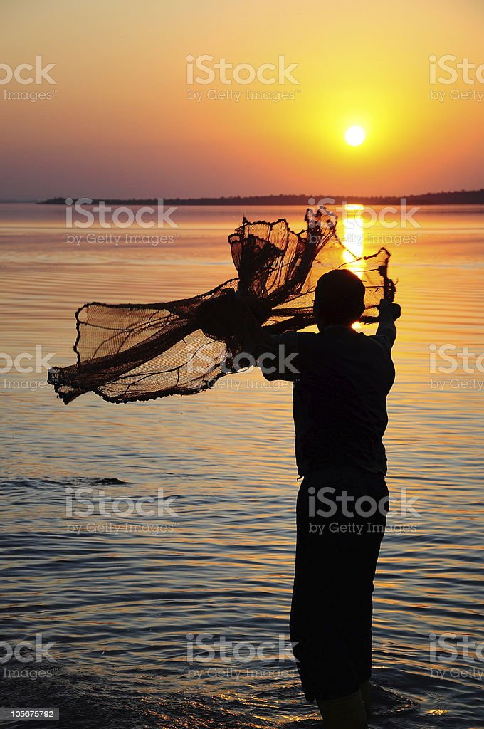 fisherman and sunset royalty-free stock photo