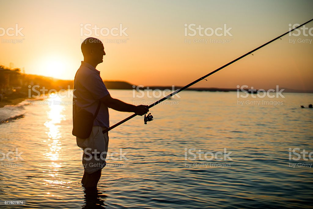 Fisherman and the sunset stock photo