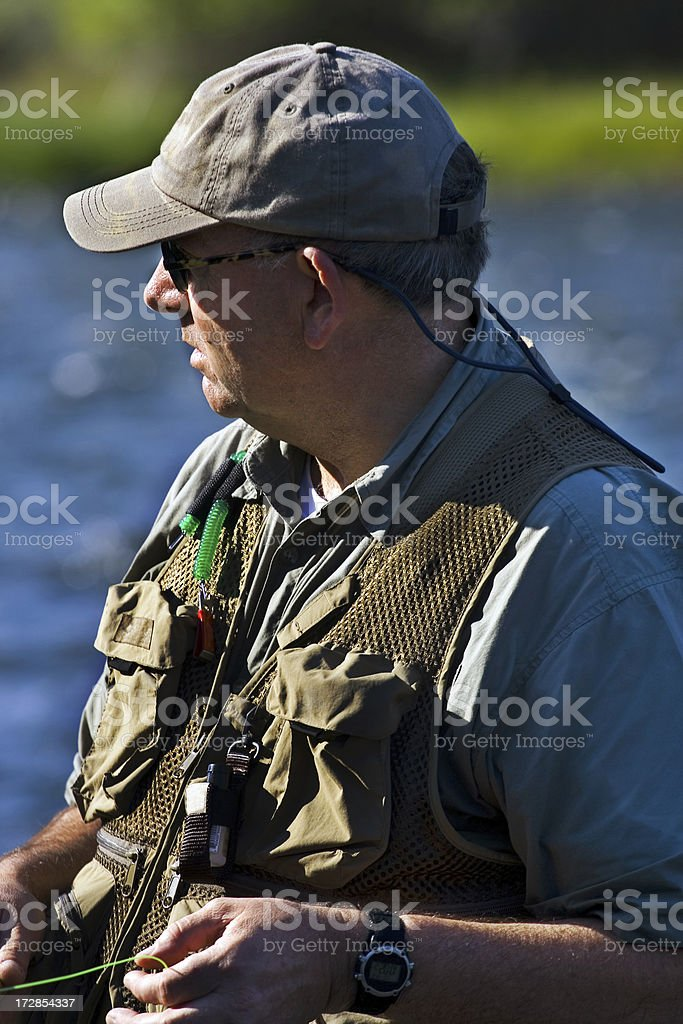 fisherman at dusk royalty-free stock photo