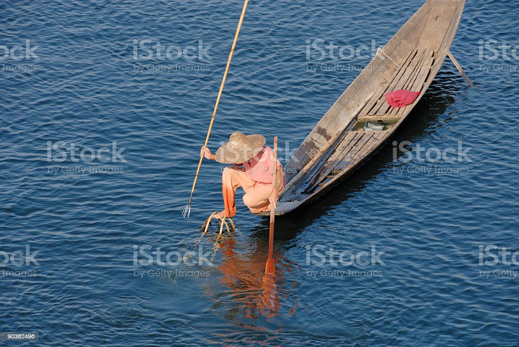 Fisherman at Inle Lake - spear fishing stock photo