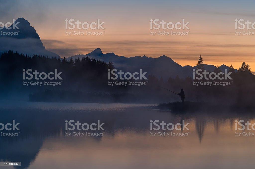 Fisherman at Lake Geroldsee royalty-free stock photo