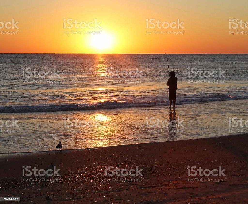 Fisherman at Sunrise stock photo