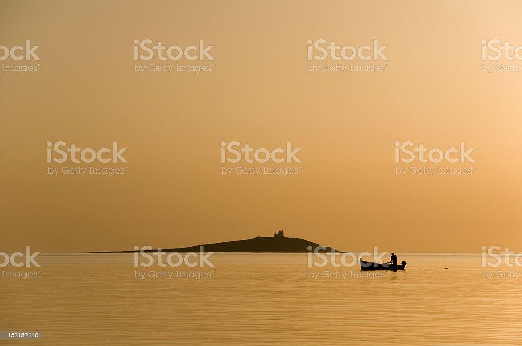Fisherman at the sunset royalty-free stock photo