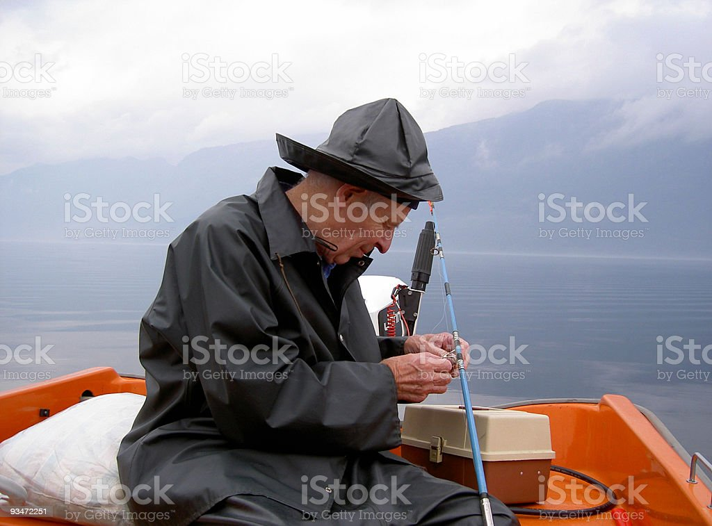 Fisherman baiting  in early morning by a Norweigian fjord. royalty-free stock photo