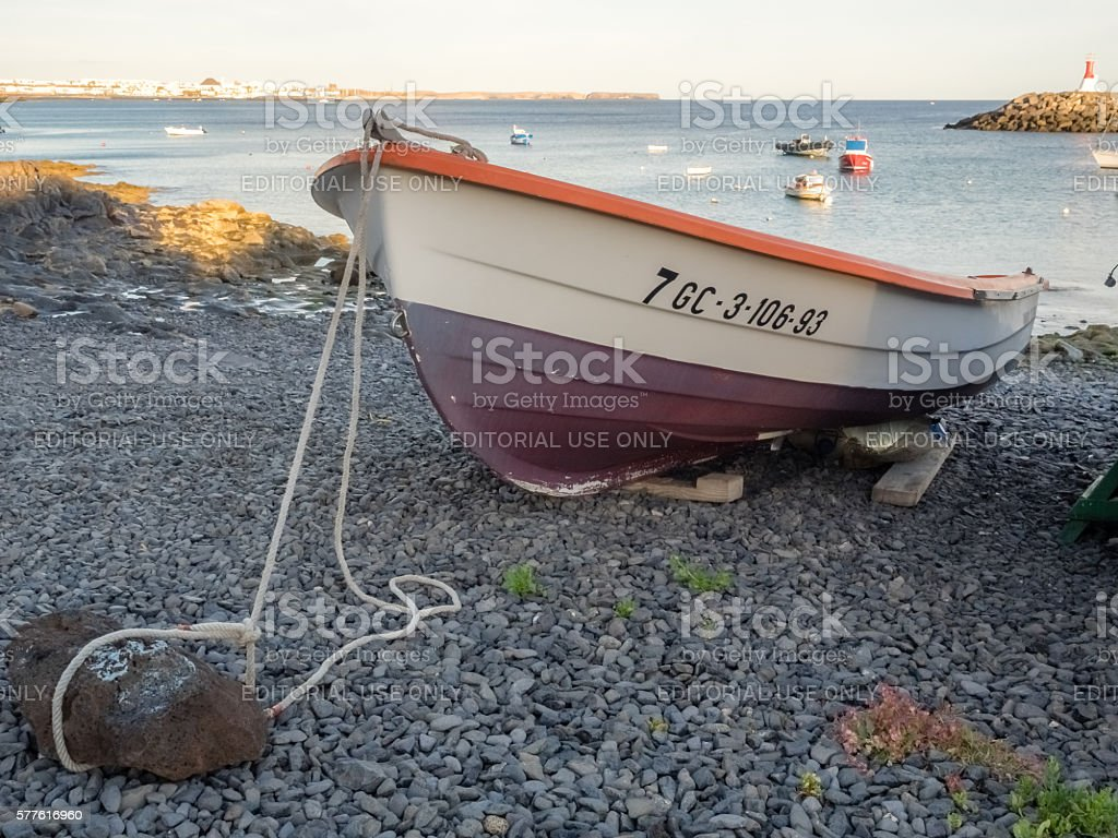 Fisherman boat on a shore stock photo