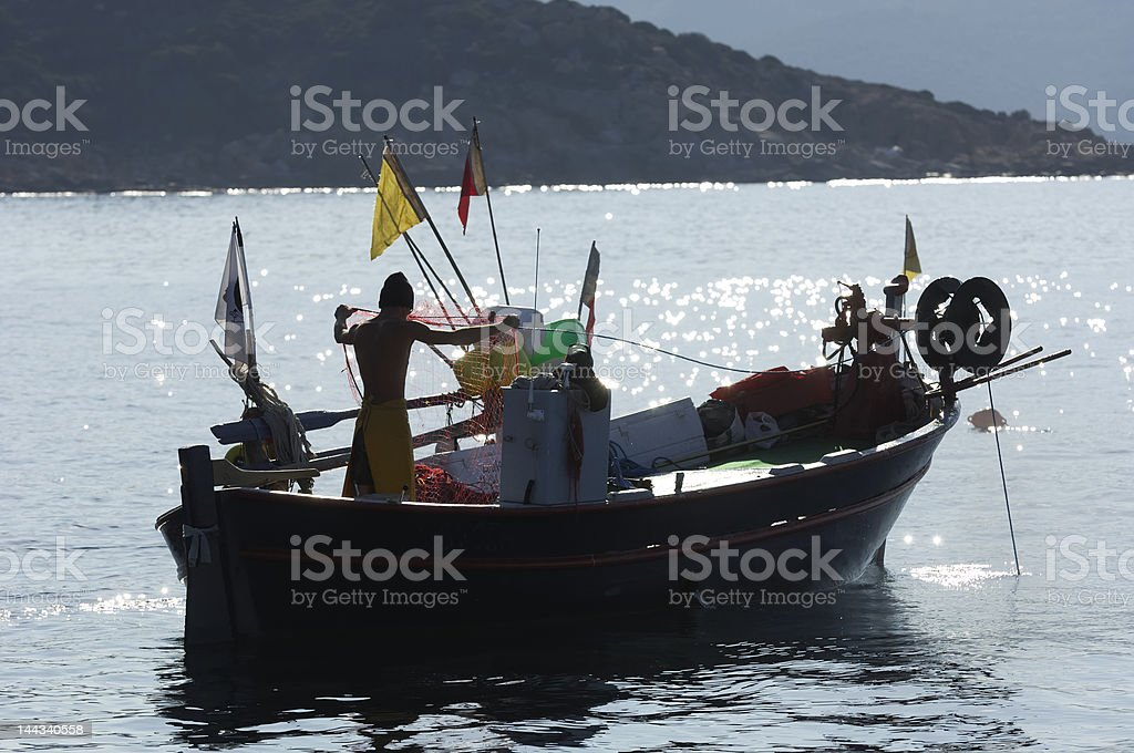 fisherman boat with the fishing net royalty-free stock photo