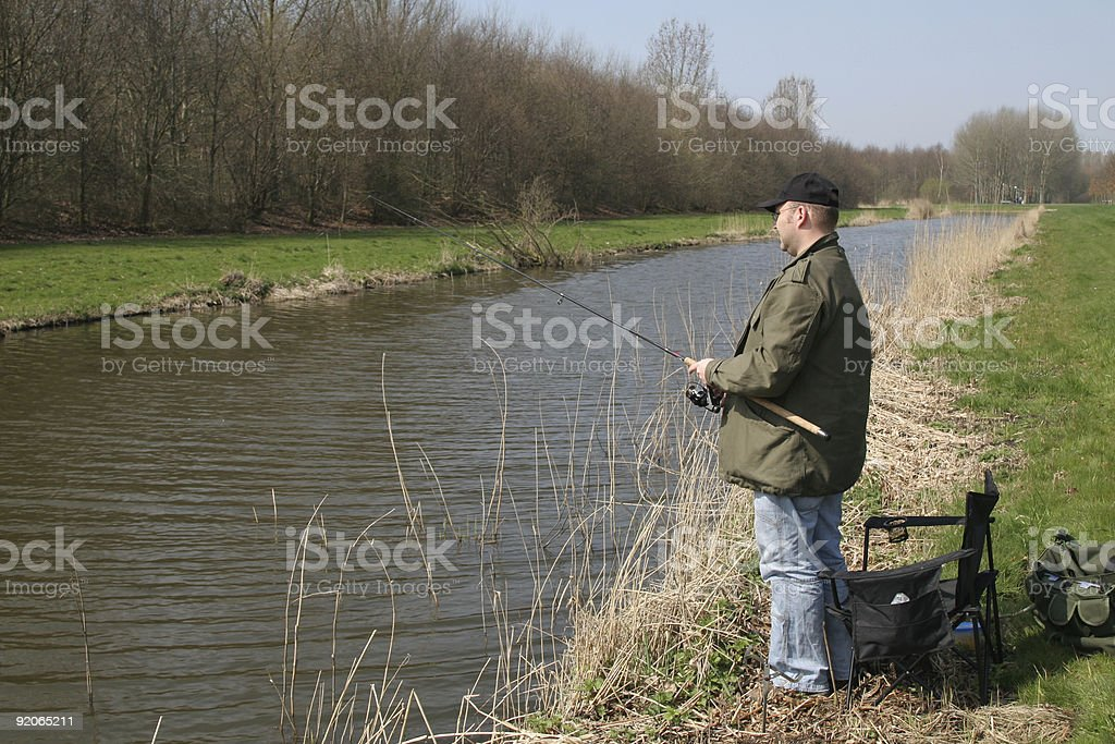 Fisherman by the waterside stock photo