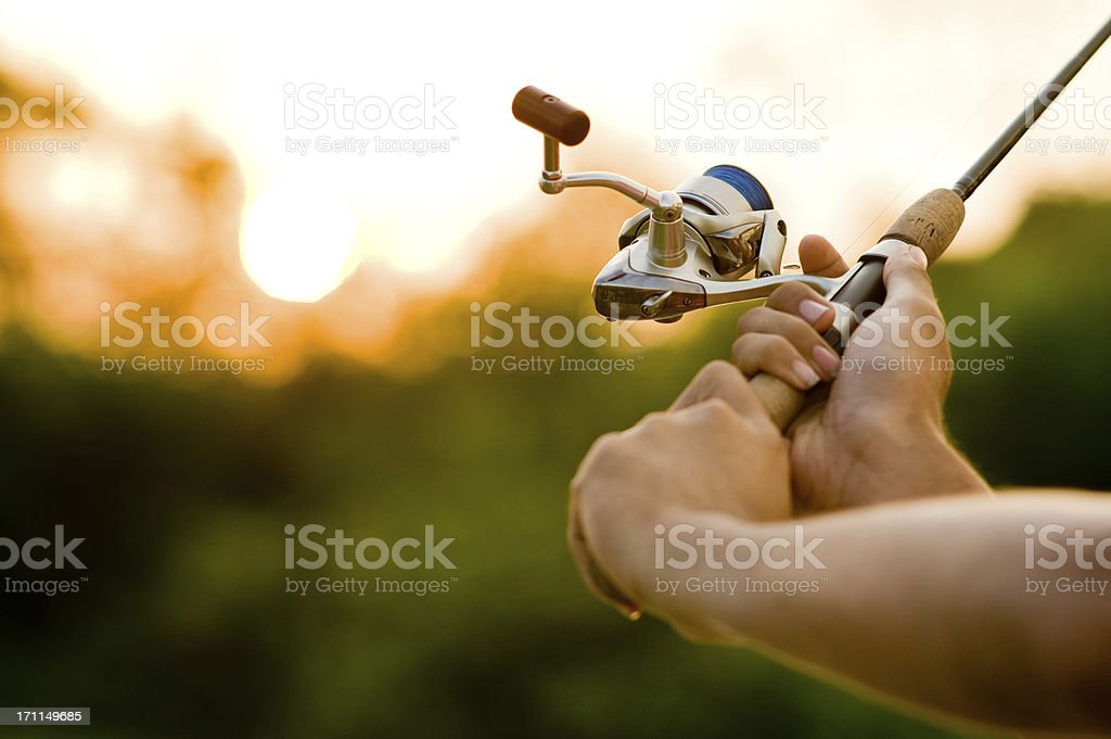 Fisherman Casting in Soft Focus. stock photo