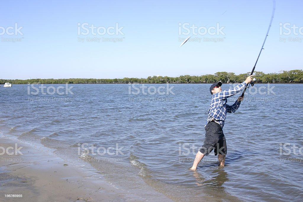 Fisherman Casting Line with Bait royalty-free stock photo