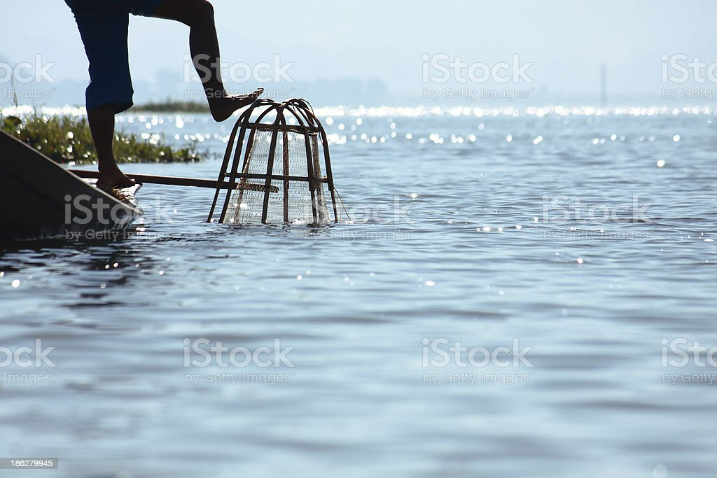 Fisherman catches fish for food stock photo
