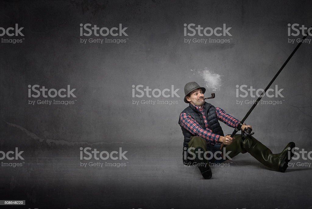 fisherman catching a big fish stock photo
