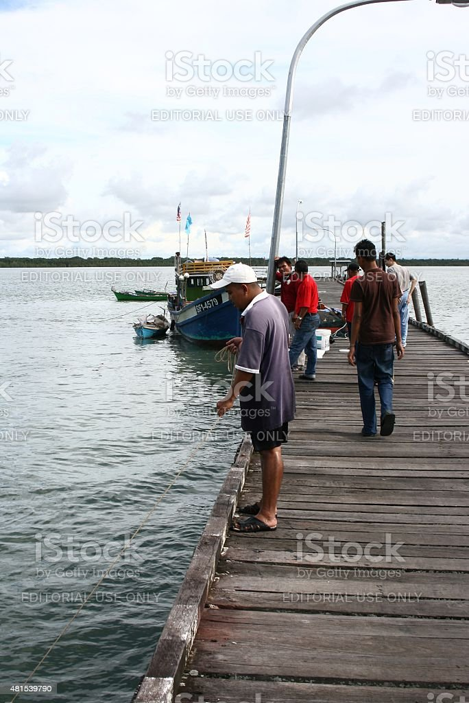 Fisherman caught fish in Muara Terbas, Kuching, Sarawak stock photo