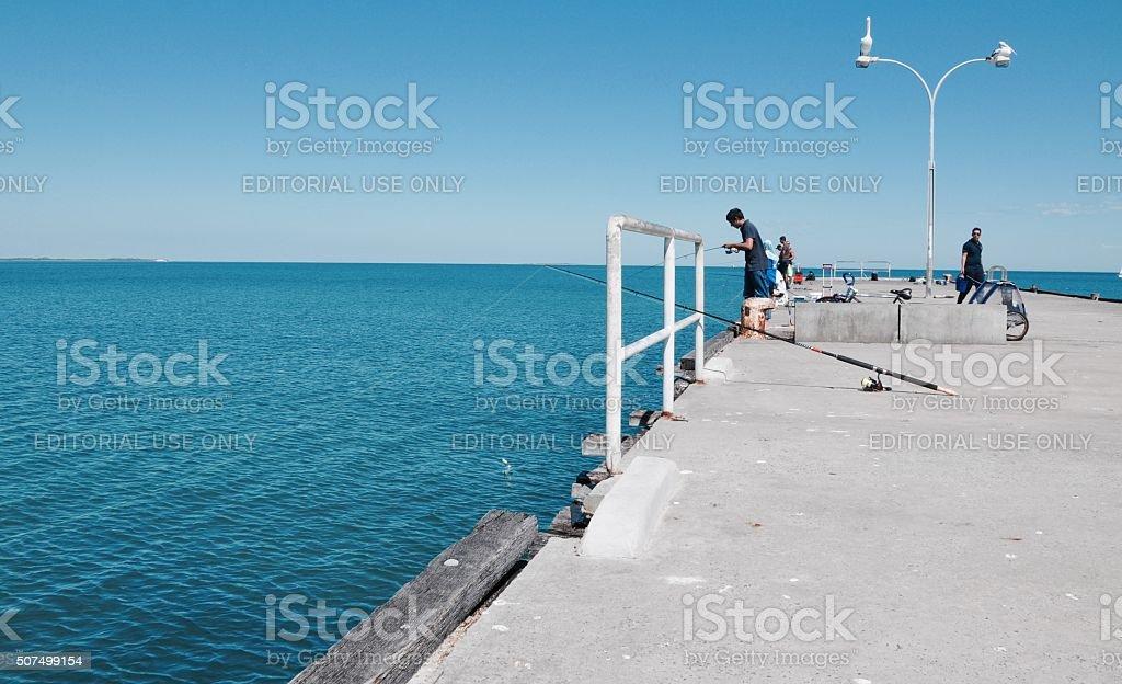 Fisherman: Coogee Beach Jetty stock photo