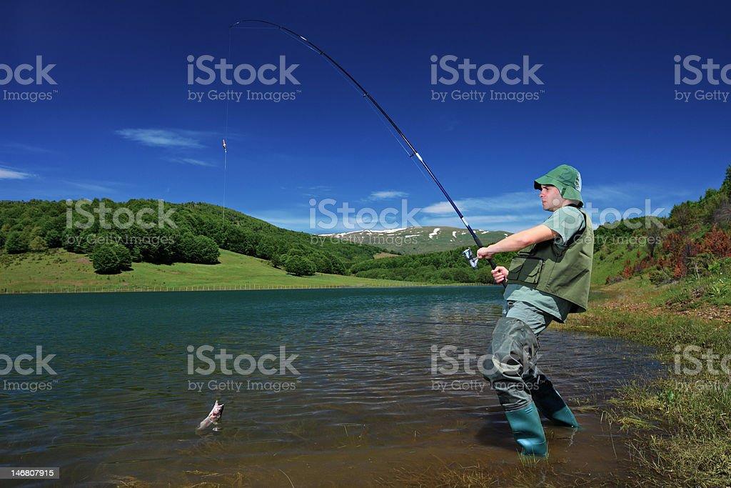 Fisherman fishing on a Mavrovo lake royalty-free stock photo