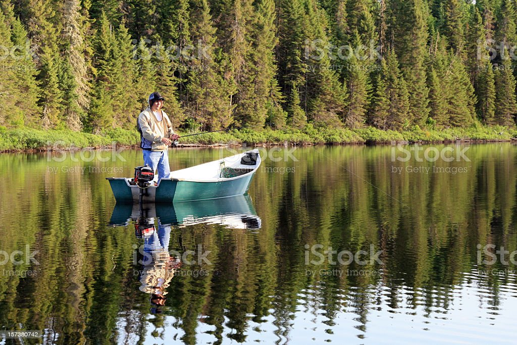 Fisherman fishing on a Quiet Lake stock photo