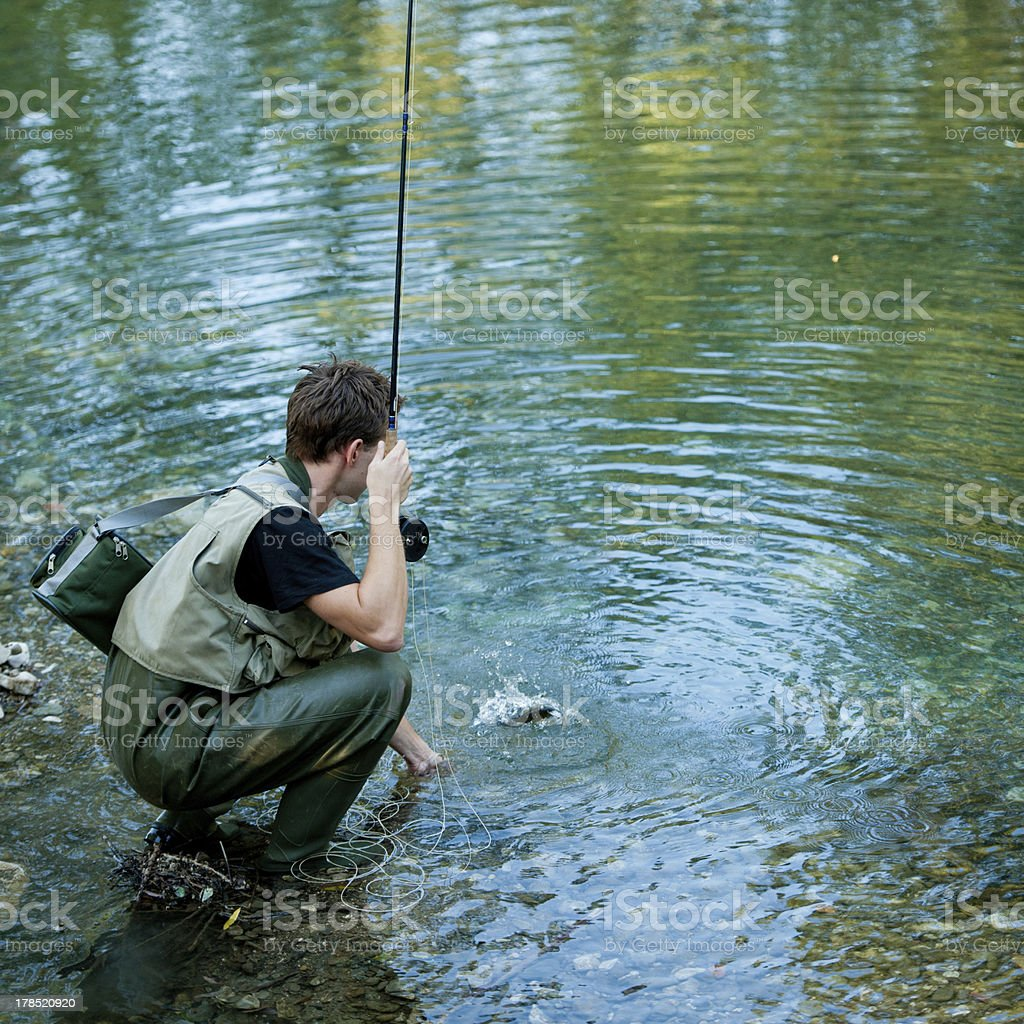 fisherman fishing on a river royalty-free stock photo