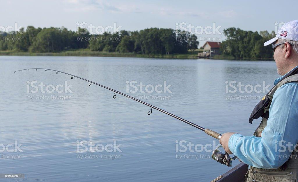 Fisherman fishing spinning stock photo