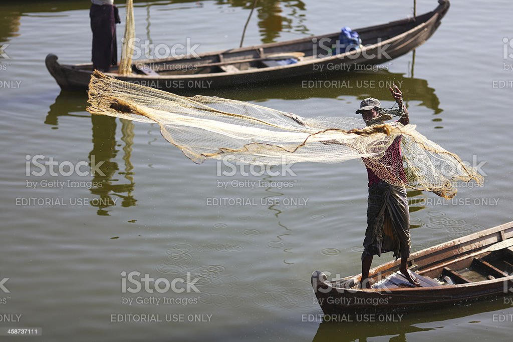 Fisherman fishing with nets in Myanmar royalty-free stock photo