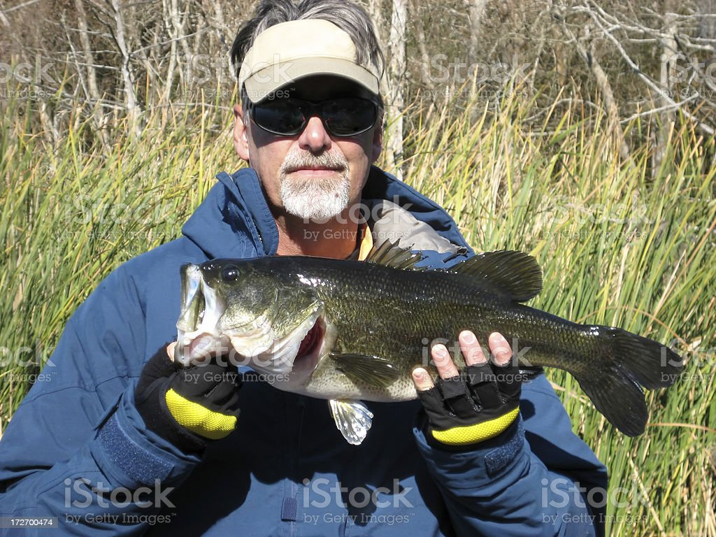 Fisherman Holding Big Bass royalty-free stock photo