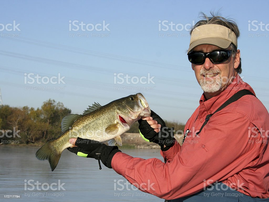 Fisherman Holding Large Mouth Bass stock photo