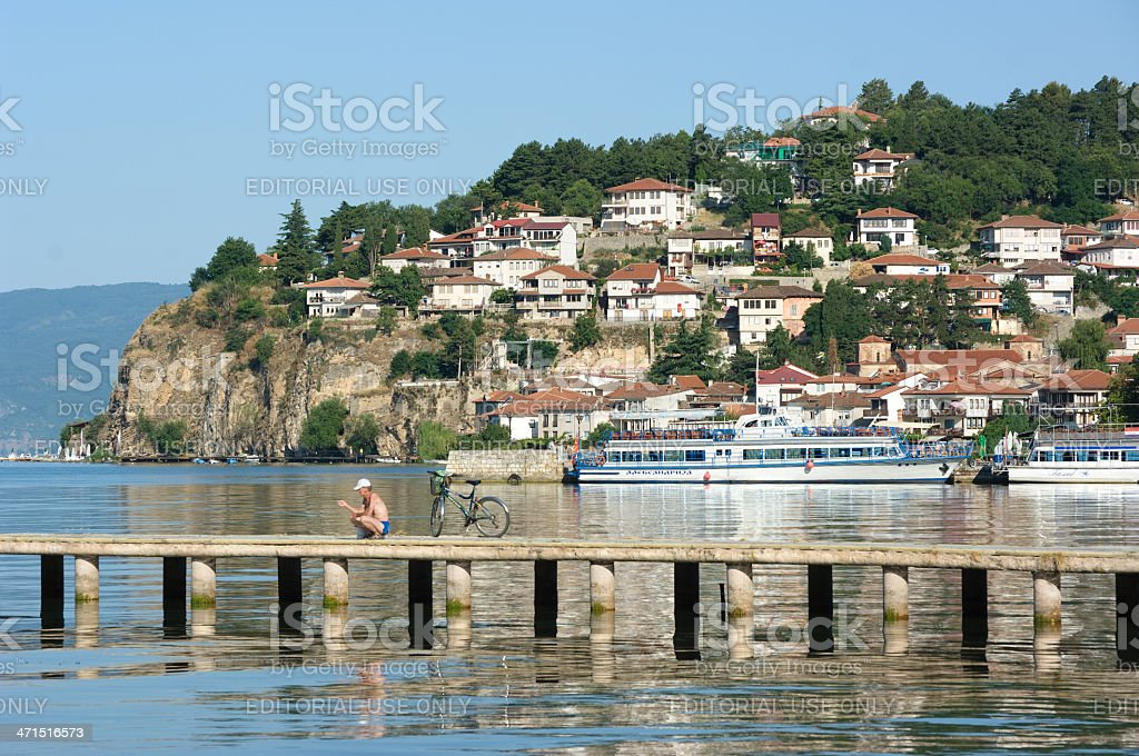 Fisherman In A Bay Of Ohrid City royalty-free stock photo