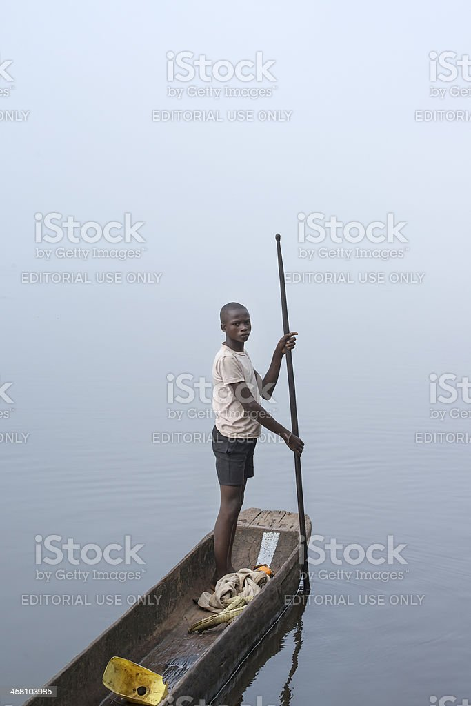 Fisherman in a pirogue on Congo River stock photo