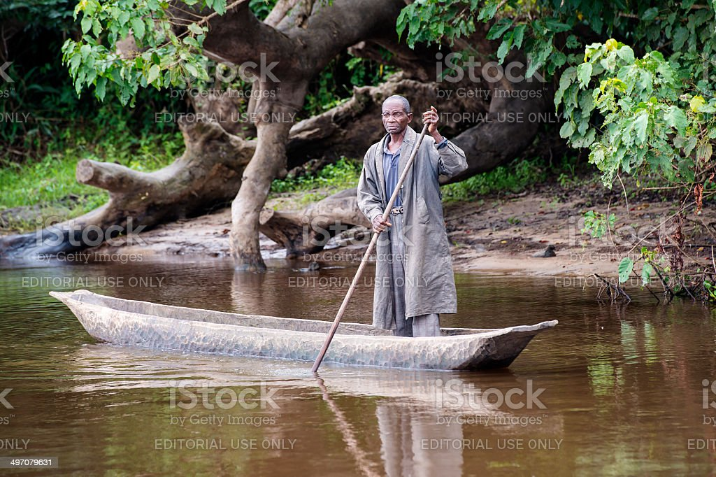 Fisherman in a pirogue on Congo River royalty-free stock photo