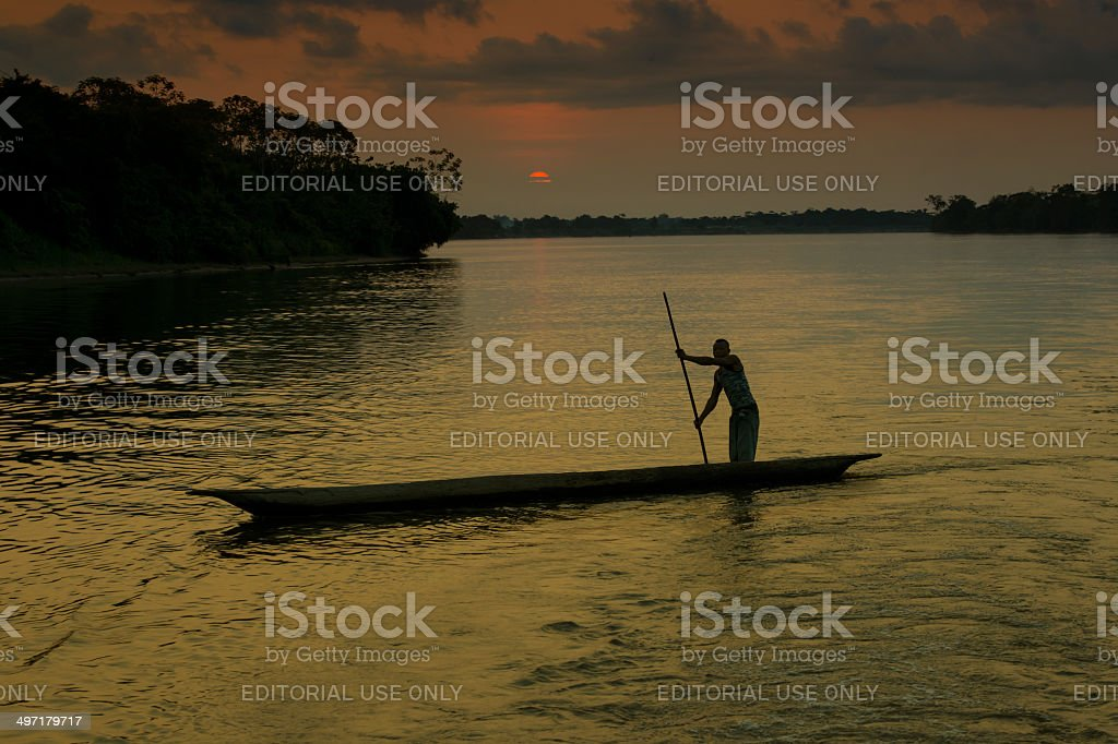 Fisherman in a pirogue on the Congo River stock photo