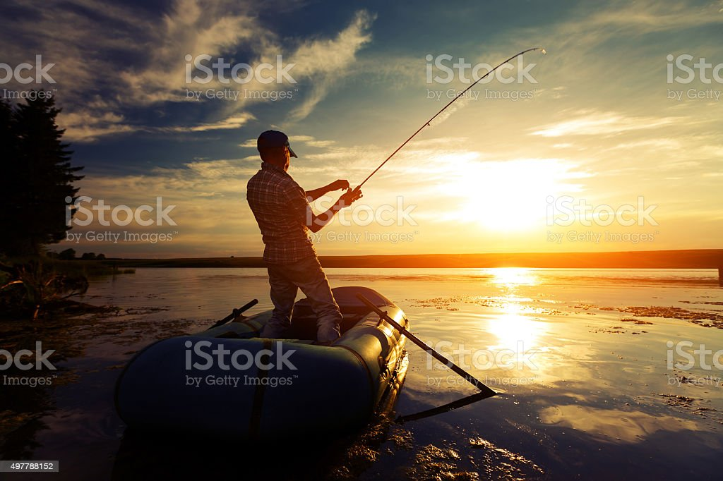 Fisherman in a pond stock photo