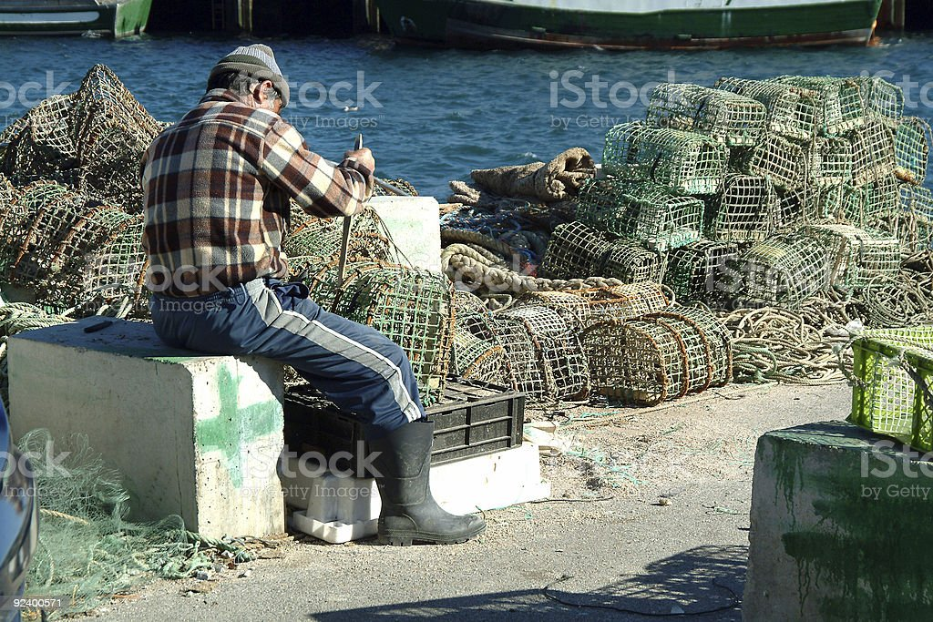 Fisherman in harbor royalty-free stock photo