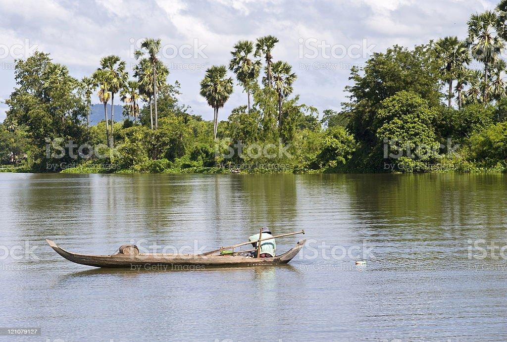 Fisherman in his boat at Tonle Sap, Cambodia. stock photo