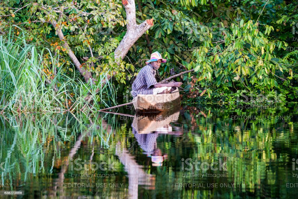 Fisherman in his pirogue on Congo River stock photo