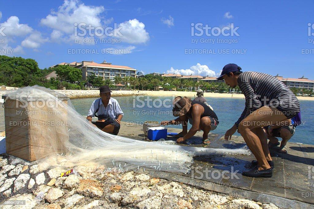 Fisherman in Nusa Dua Beach Bali stock photo