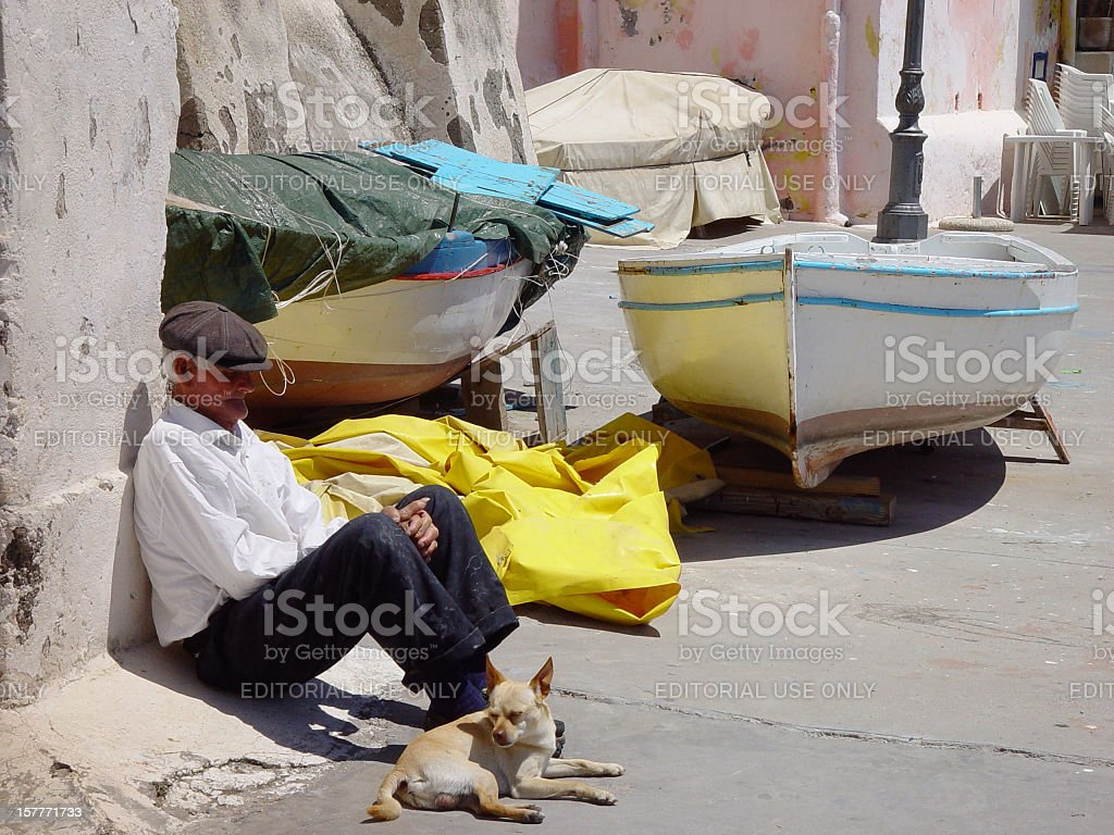 Fisherman in Procida Island, Naples, Italy stock photo