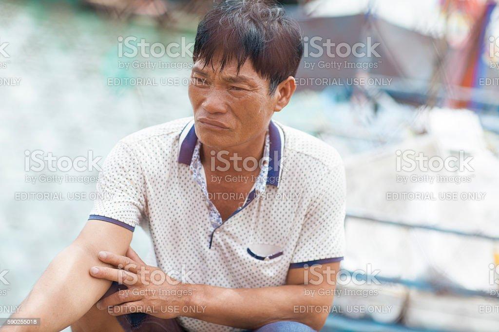 Fisherman in Sanya, Hainan island, in South China Sea stock photo